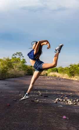 dancing woman wearing blue vest